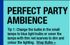 Change the bulbs in the small lamps to red light bulbs or cover the lamps with thin red scarves to dim and colour the lighting.