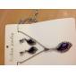 Halvmåneformet juvel halskæde og øreringe